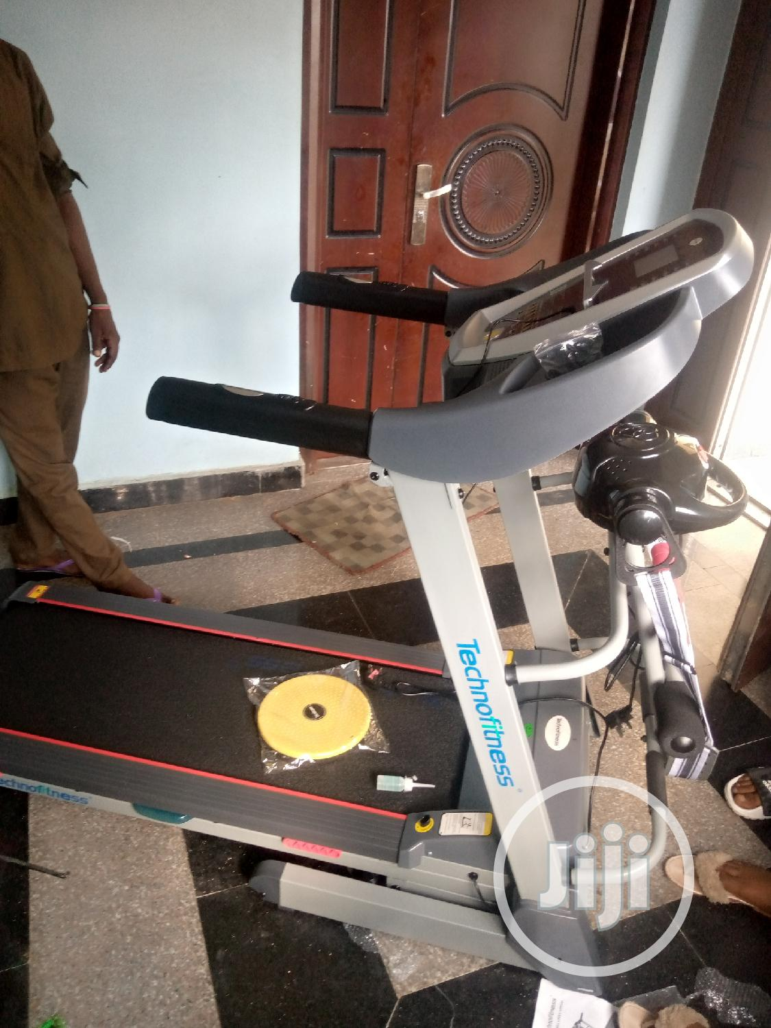 Archive: Technofitness 2.5hp Treadmill With Massager,Dumbbell and Twister