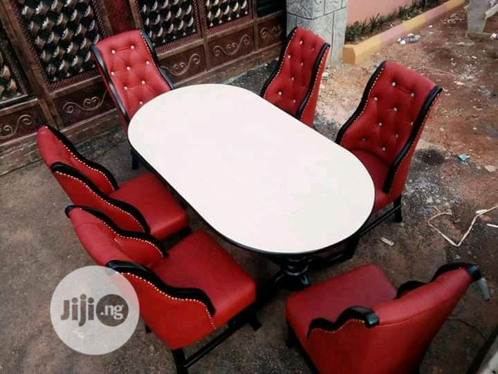 Dining Table And Six Chairs With Fabric And A Good Leader