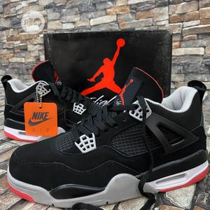"""Air Jordan 4 Retro """"Bred"""" Black/Red Sneakers Available   Shoes for sale in Lagos State, Surulere"""