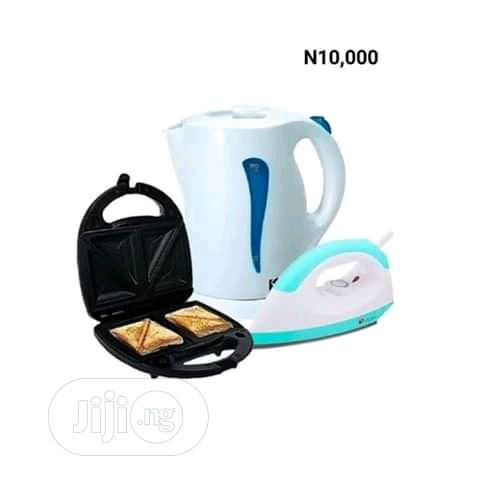 Set Of Toaster, Electric Jug And Iron
