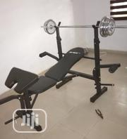 Weight Bench + Barbell + 50kg Plates | Sports Equipment for sale in Lagos State, Surulere