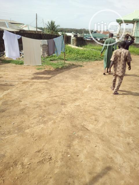 Half Plot of Land With a Building on It at Egan, Lagos | Land & Plots For Sale for sale in Alimosho, Lagos State, Nigeria