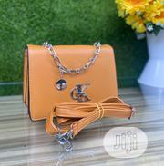 Orange Ladies Quality Handbag | Bags for sale in Ondo State, Isua