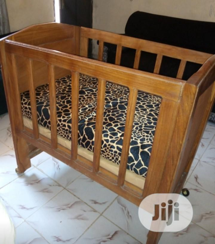 Used Polished Wood Baby Cot