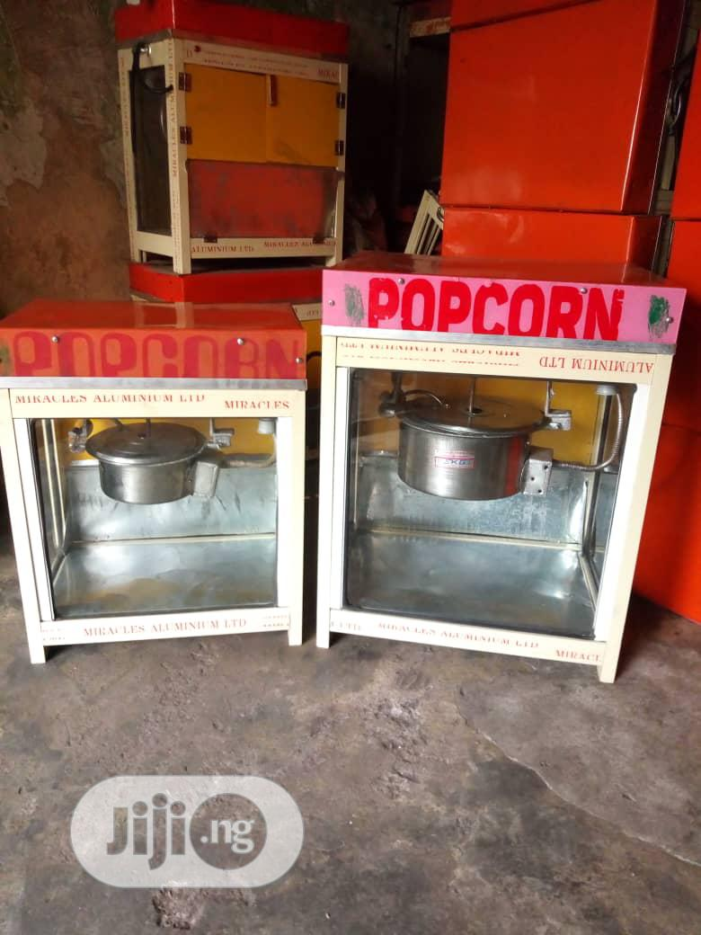 This Is Electric Popcorn Making Machine Is Popping Very Well.