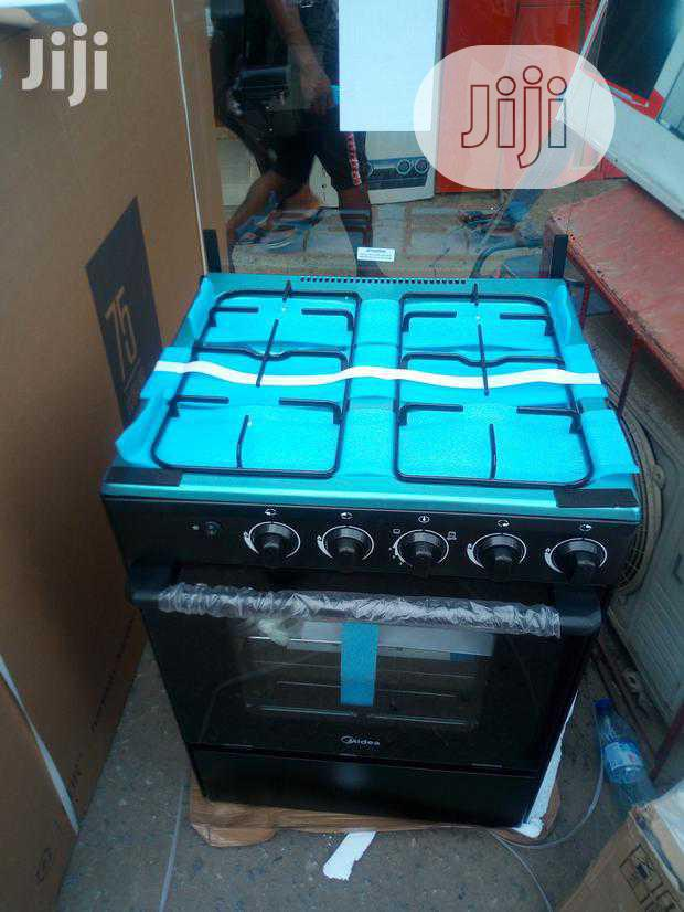 Brand New Midea Standing 4buners 60 by 60cm Gas Cooker With Oven