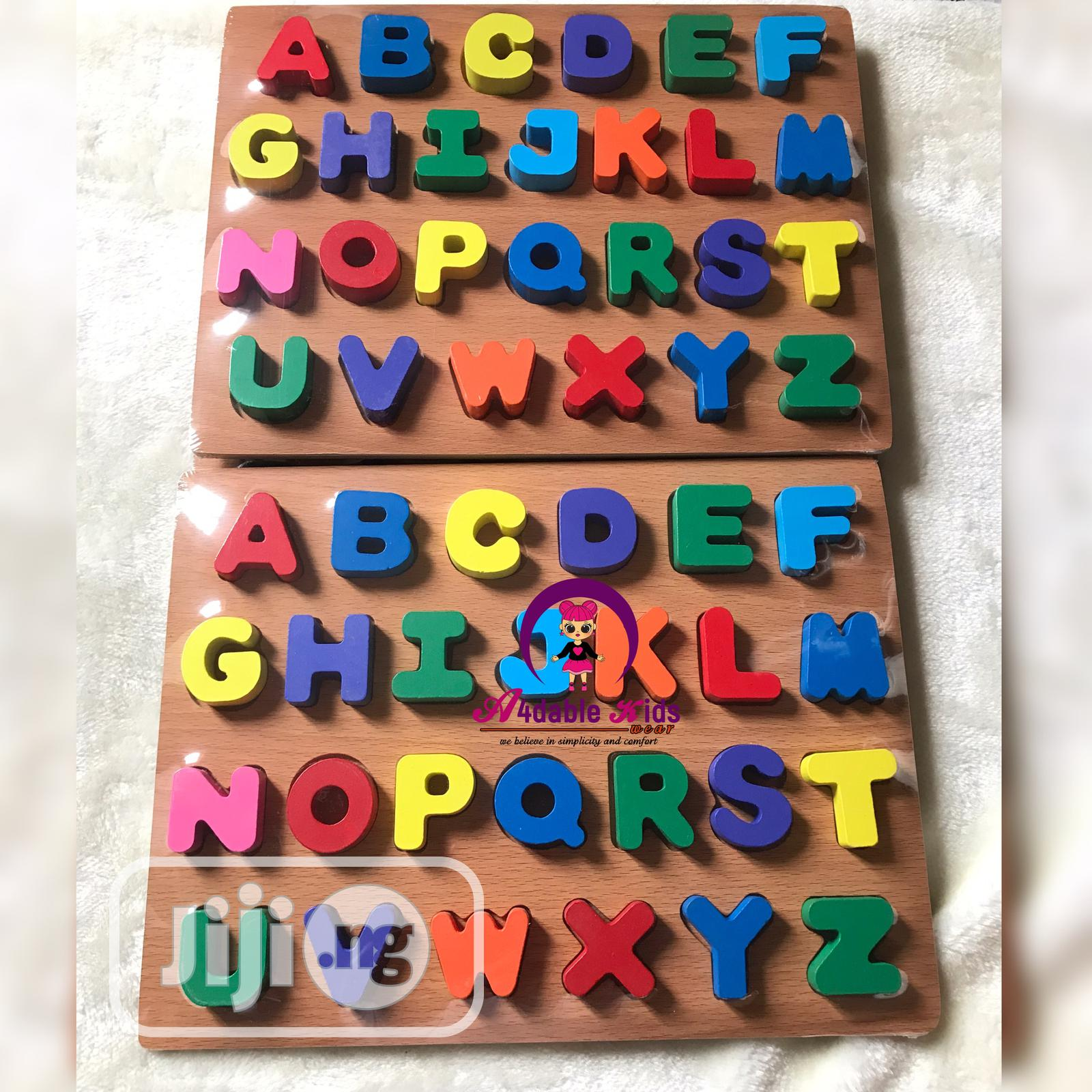 Archive: Numbers and Alphabet Wooden Puzzle