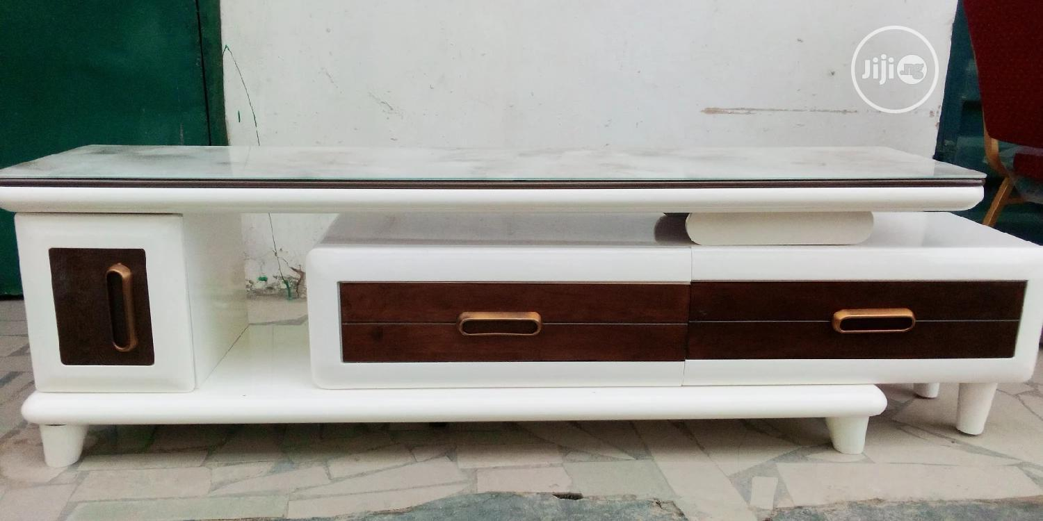 Tv Stand Cream And Brown Color.