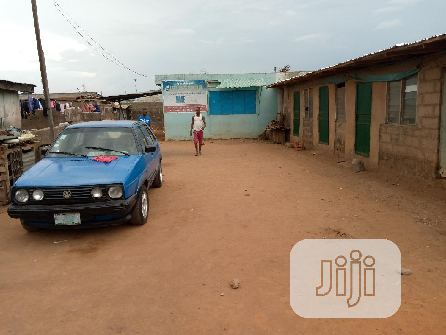 Land With Building On Top For Sale At Fagba Station Railway | Land & Plots For Sale for sale in Ifako-Ijaiye, Lagos State, Nigeria