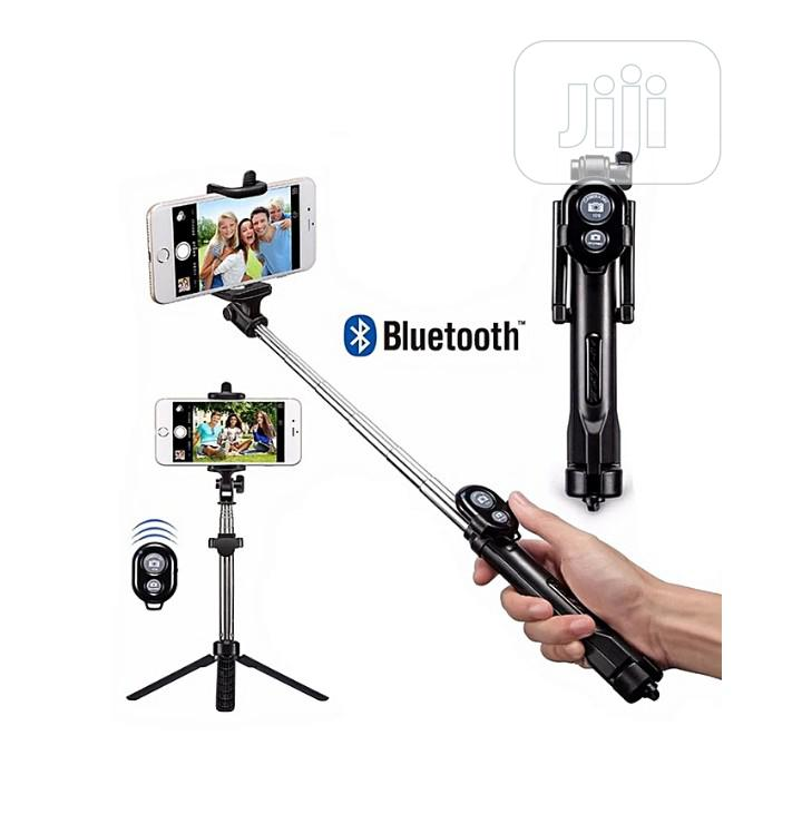 Phone Tripod Stand & Selfie Stick With Bluetooth Shutter.