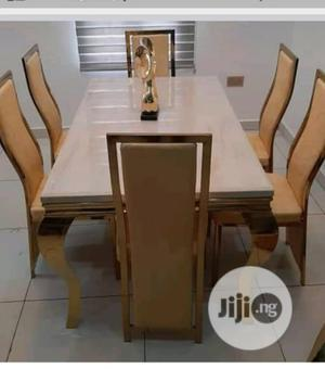 Original Quality Marble Dinning Table With 6 Chairs Gold   Furniture for sale in Lagos State, Magodo