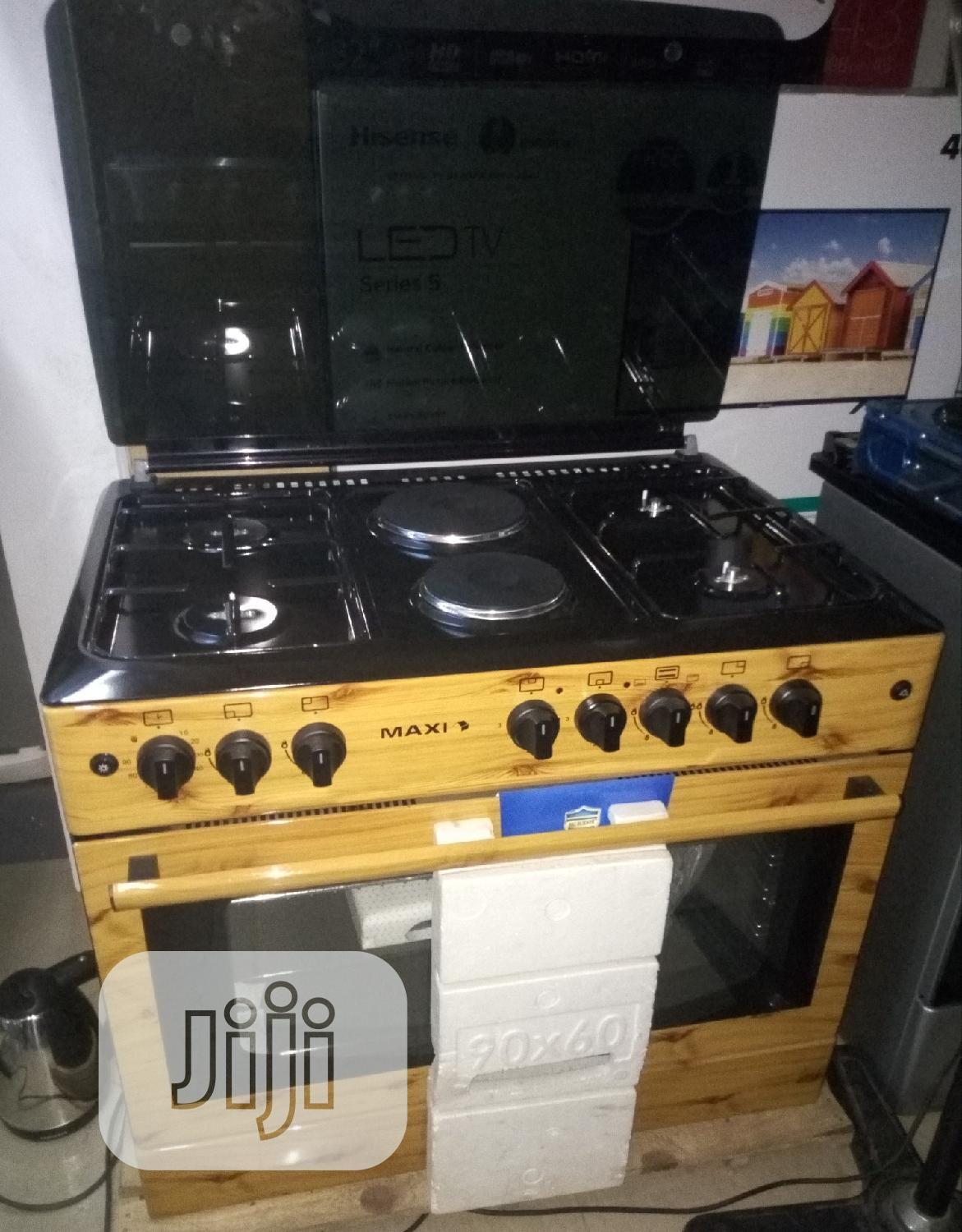 Maxi 60*90 Wood _4 Gas Burners +2 Electric Gas Cooker