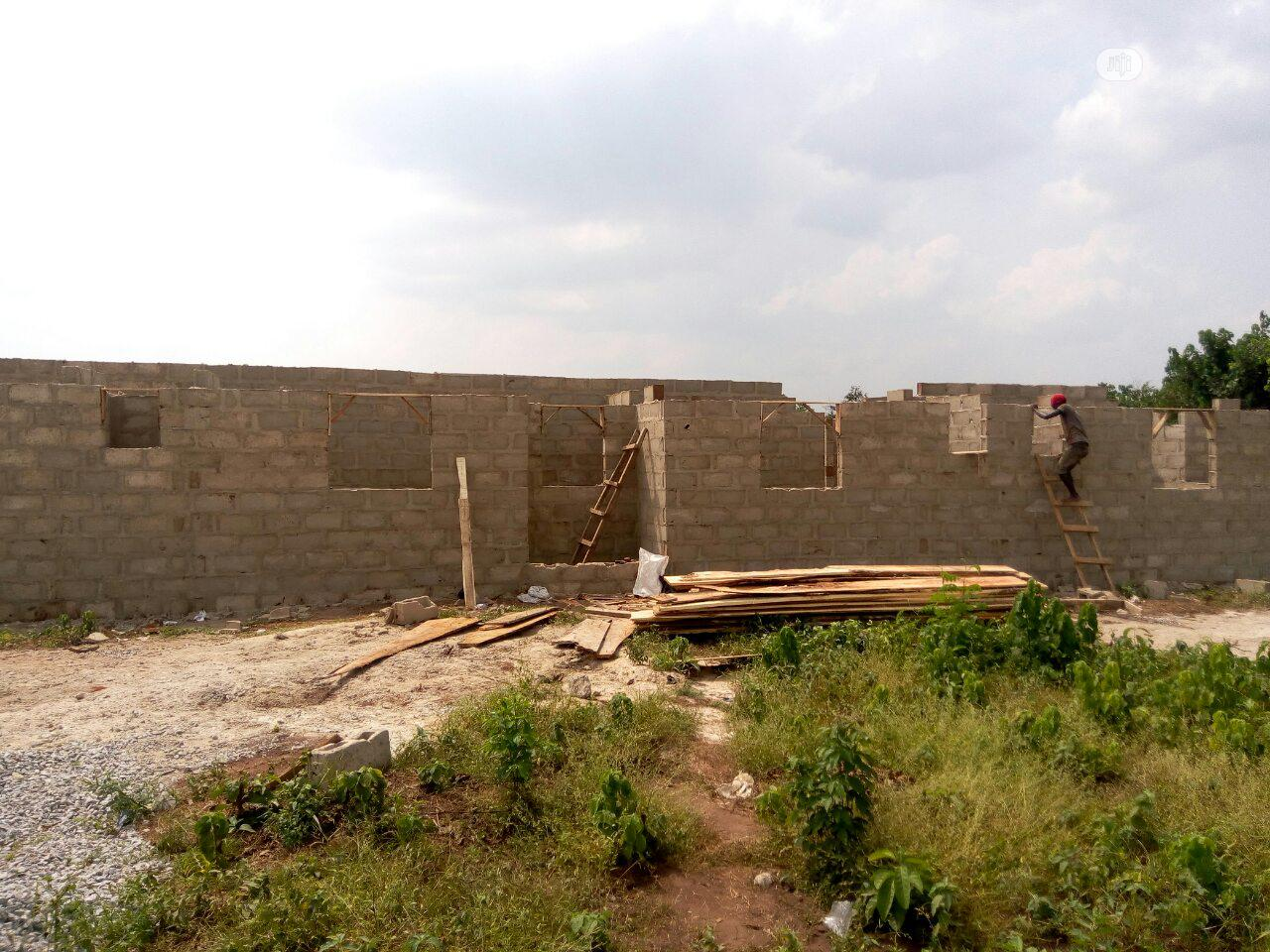 1 Plot of Land Behind Bena Farm,With Uncompleted Structure