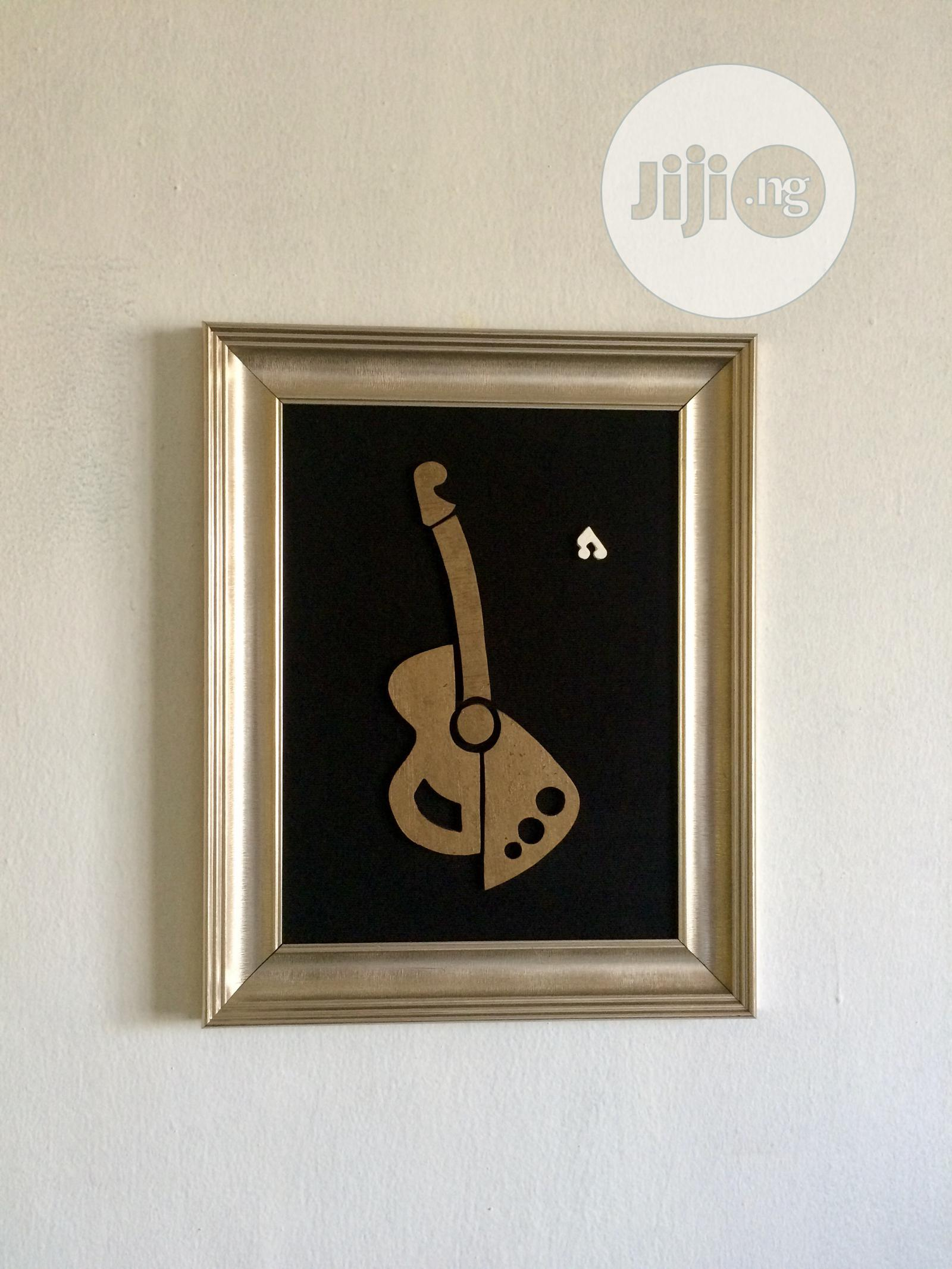 Archive: Carving Of A Guitar