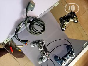 Original Xbox 360 AV Connector and Playstation 4 Controller | Video Game Consoles for sale in Edo State, Benin City