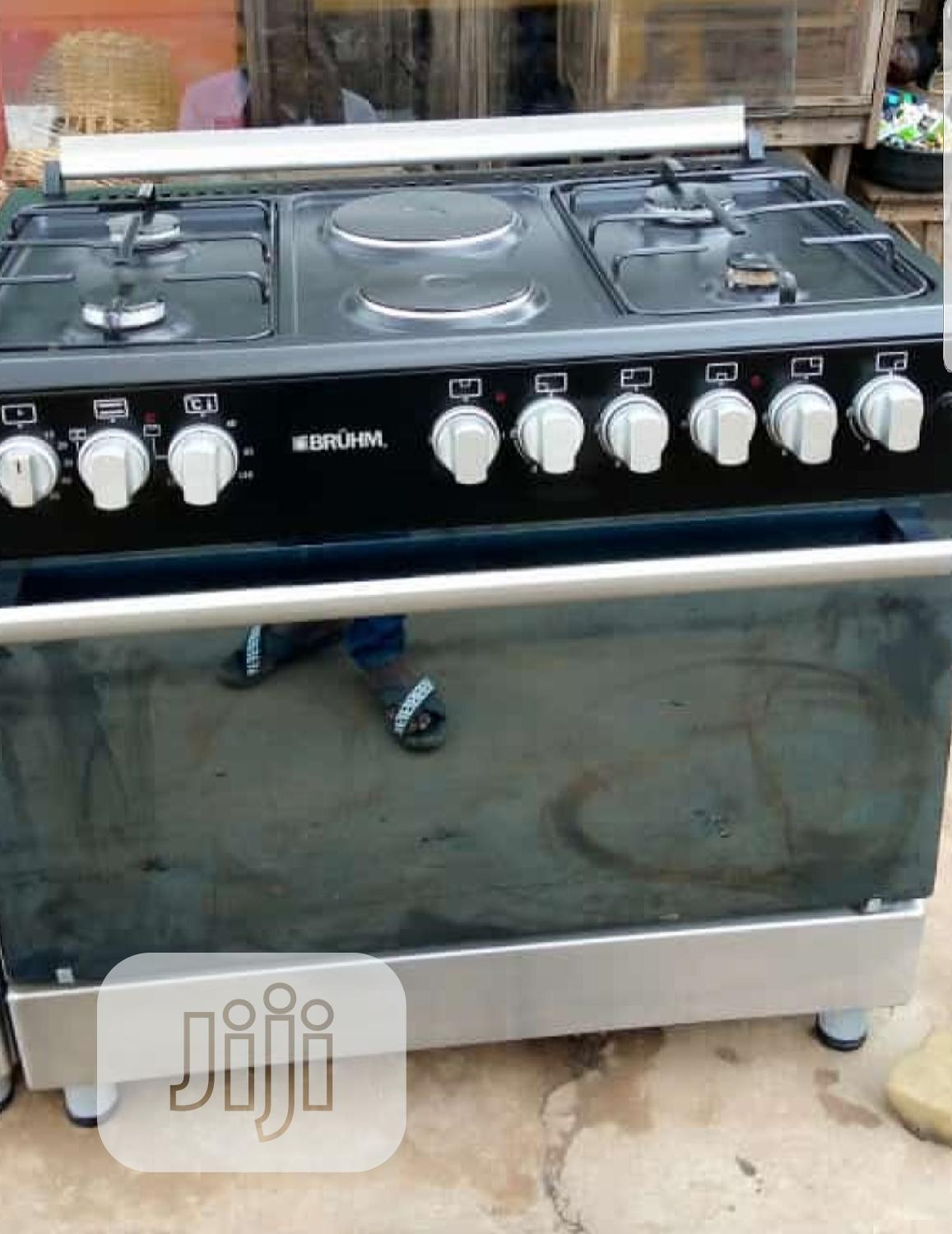 2 Electric And 4 Burner Gas Cooker With Large Oven
