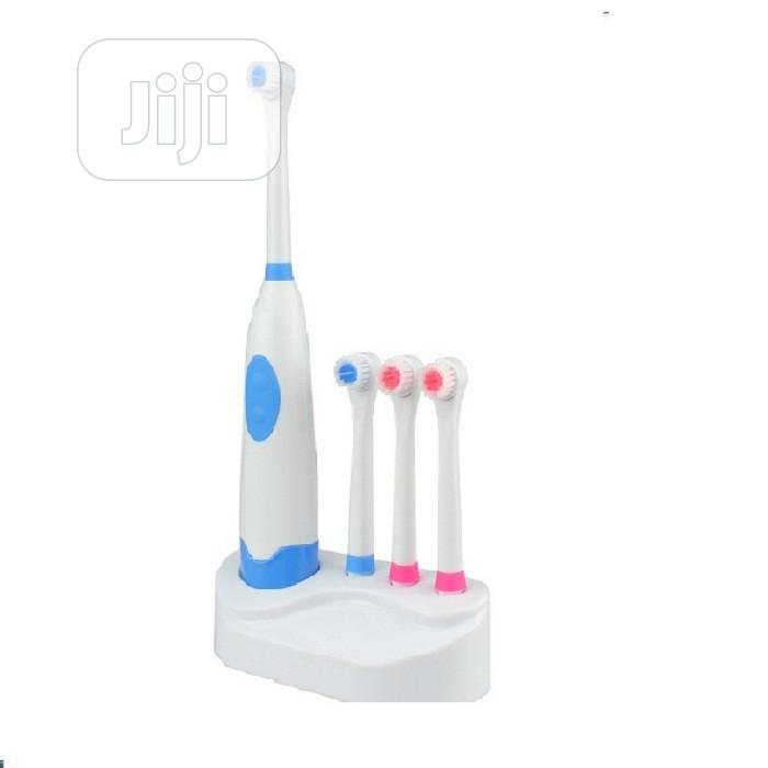Archive: Automatic Revolving Electric Toothbrush With 3 Extra Heads