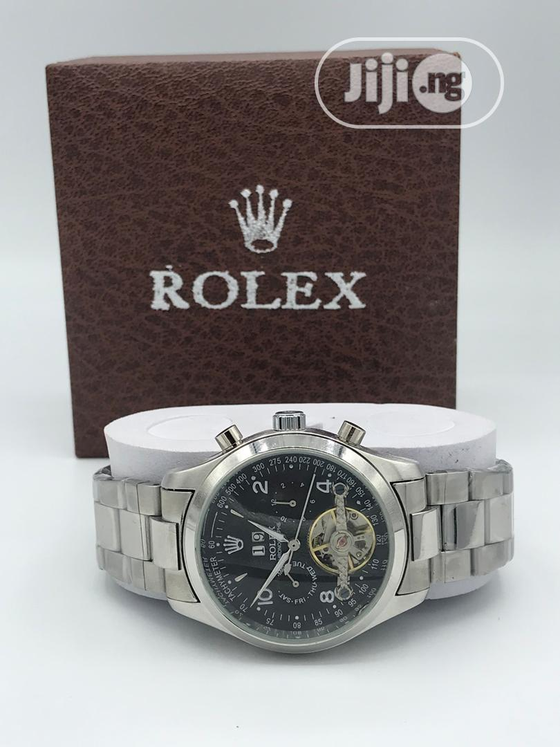 Archive: Rolex Mechanical Watch With White Face