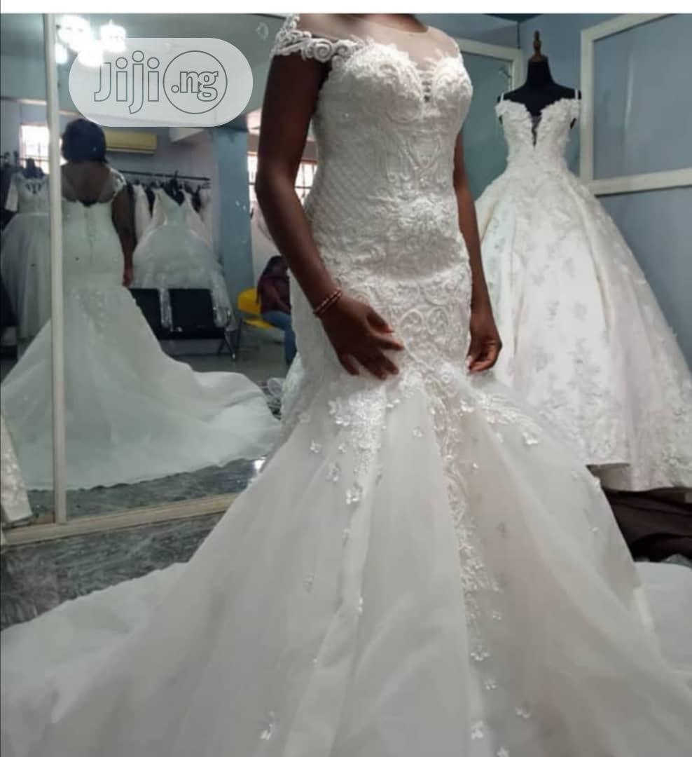 Mermaid Wedding Dress and Flower Bouquet