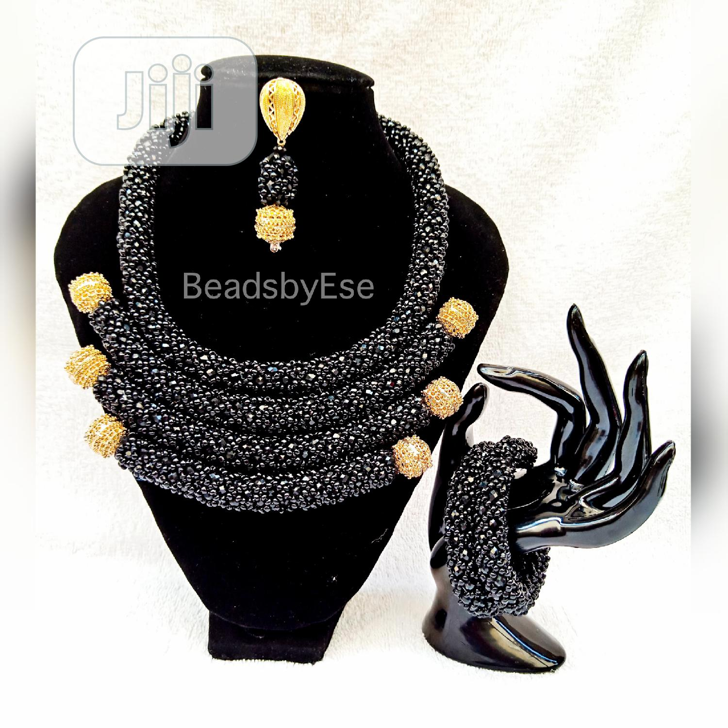 Black Beaded Bead With Gold Accessories