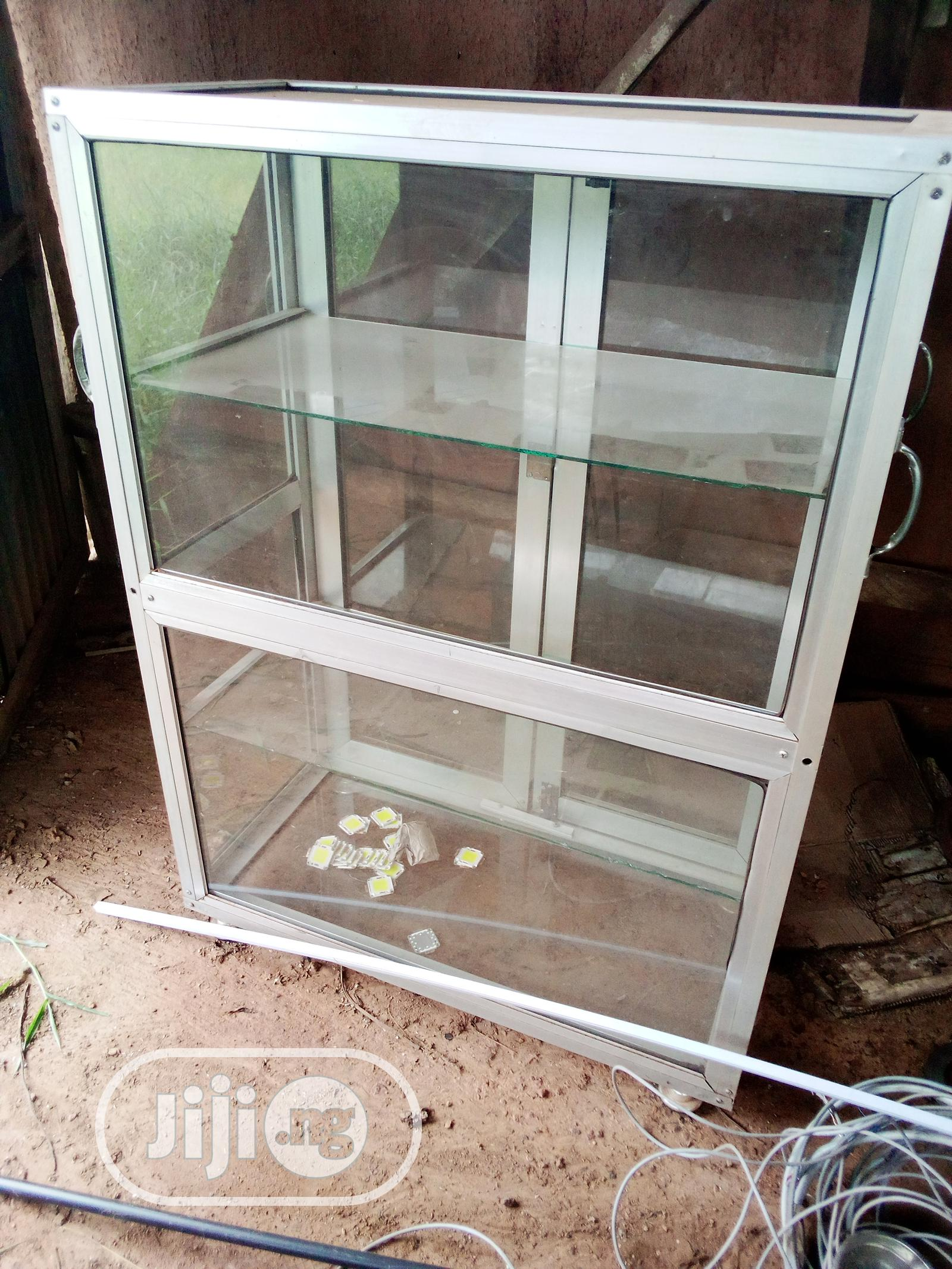 Archive: Aluminum And Glass Cabinet Double Size