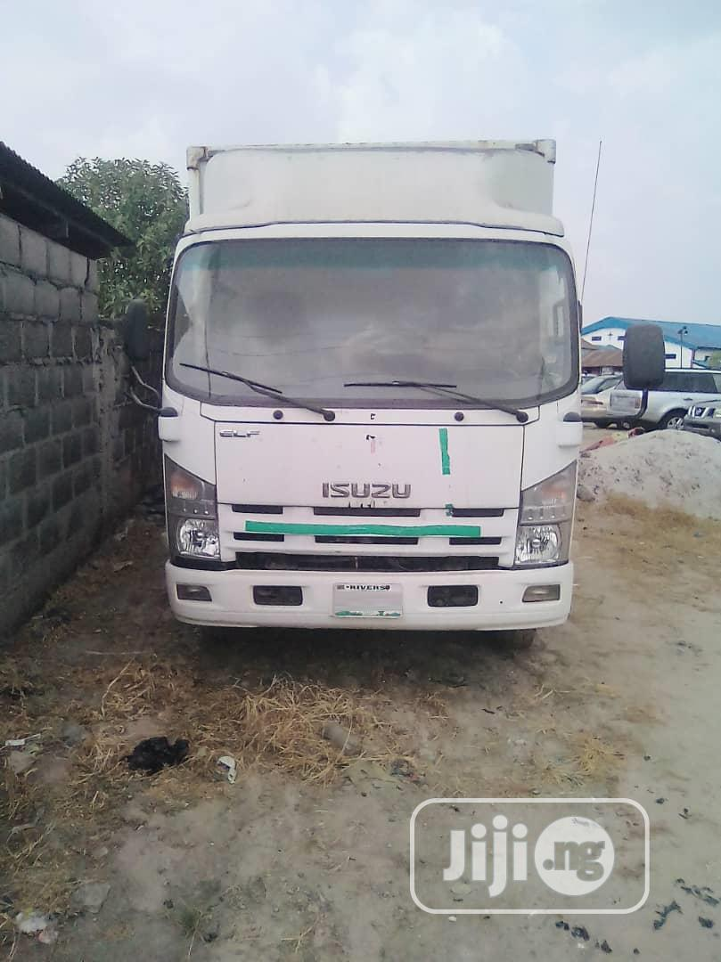 Isuzu 700P Elf Npr Cargo Truck (Must Sell Today) | Trucks & Trailers for sale in Port-Harcourt, Rivers State, Nigeria