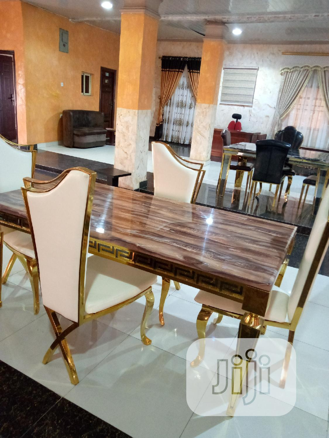 Gold Dinning Table By 4 Chairs