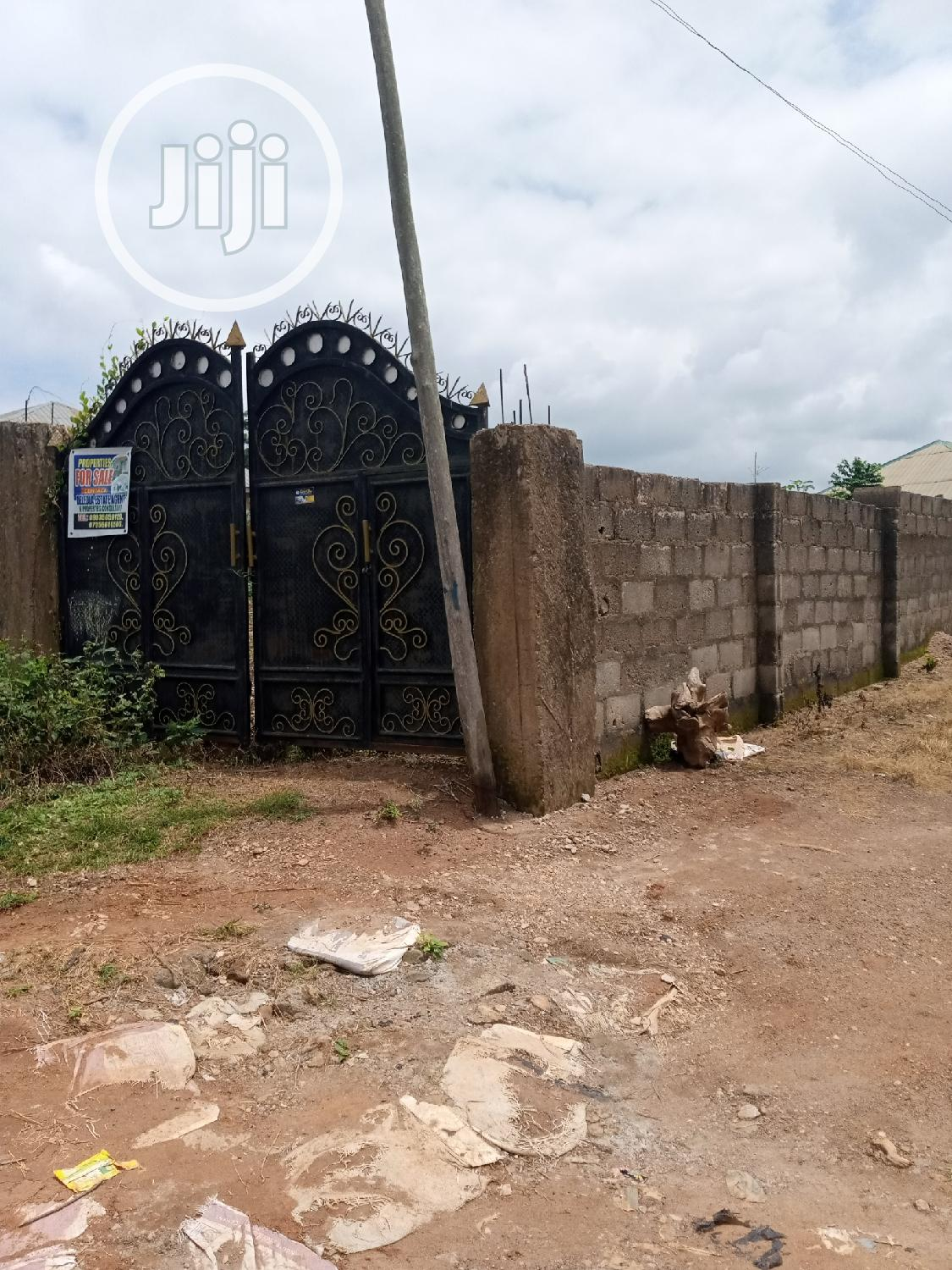 A Plot Of Land, Fully Fenced With Gate In A Cool Area.