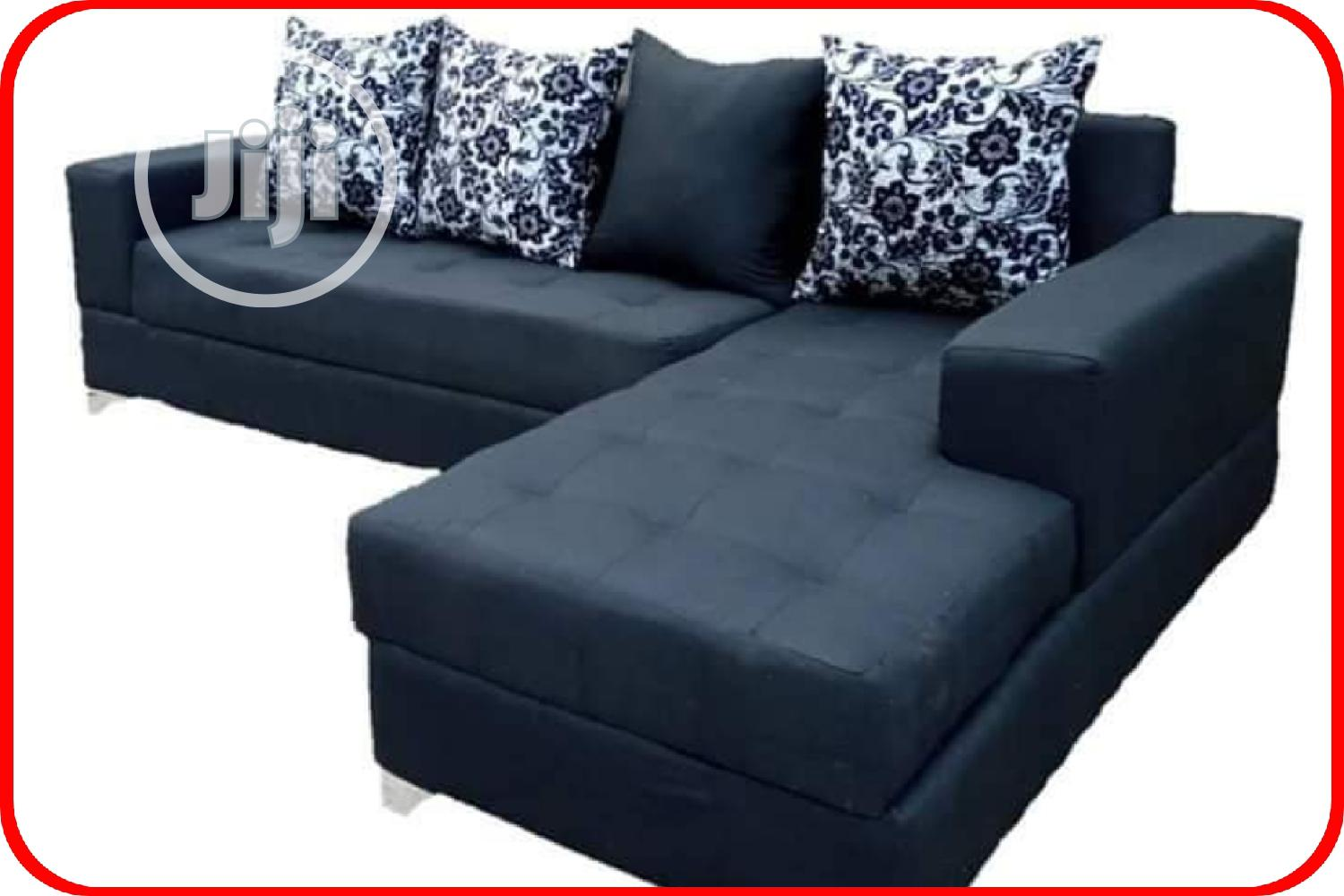L- Shaped Sofa With Throw Pillows