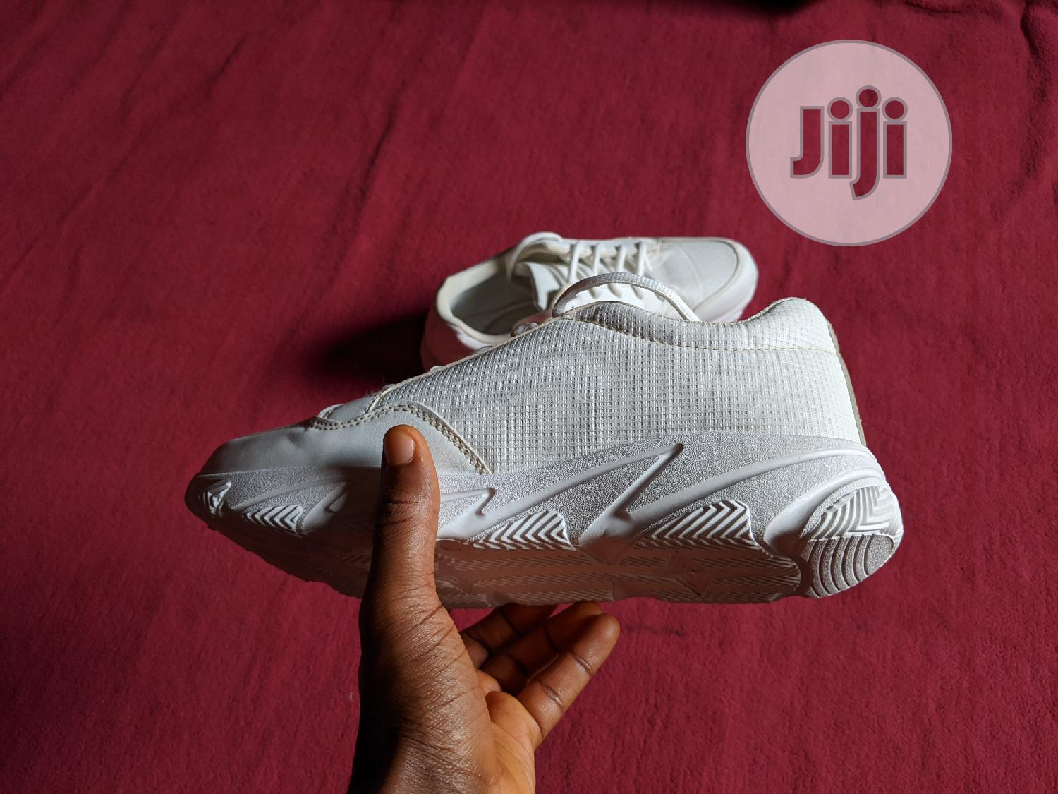 Unisex White Sneakers Shoe (Suitable For Corpers/NYSC)   Shoes for sale in Alimosho, Lagos State, Nigeria