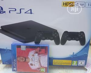 Ps4 Slim Console 1TB With 2 Game Pads and Fifa 20 Cd | Accessories & Supplies for Electronics for sale in Lagos State, Ikeja