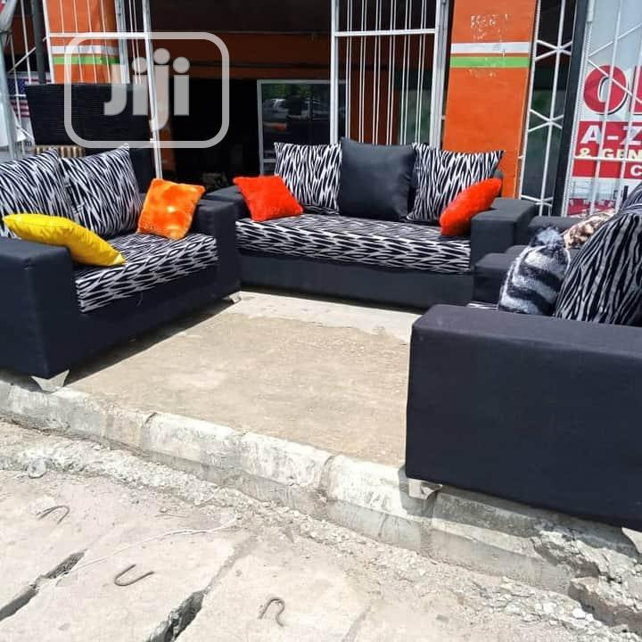 7 Seater Sofa...Accessorized With Colourful Throw Pillows