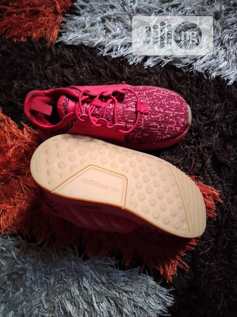 Red Sneakers for Your Cute Child