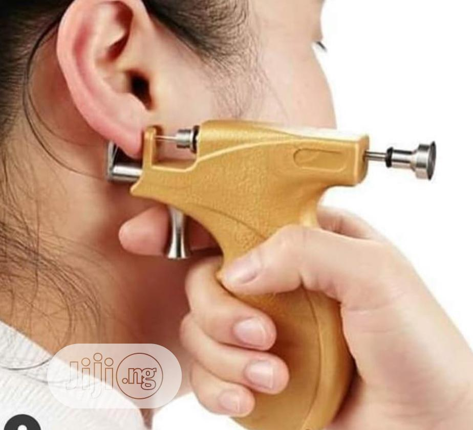 Archive: Ear Piercing Gun