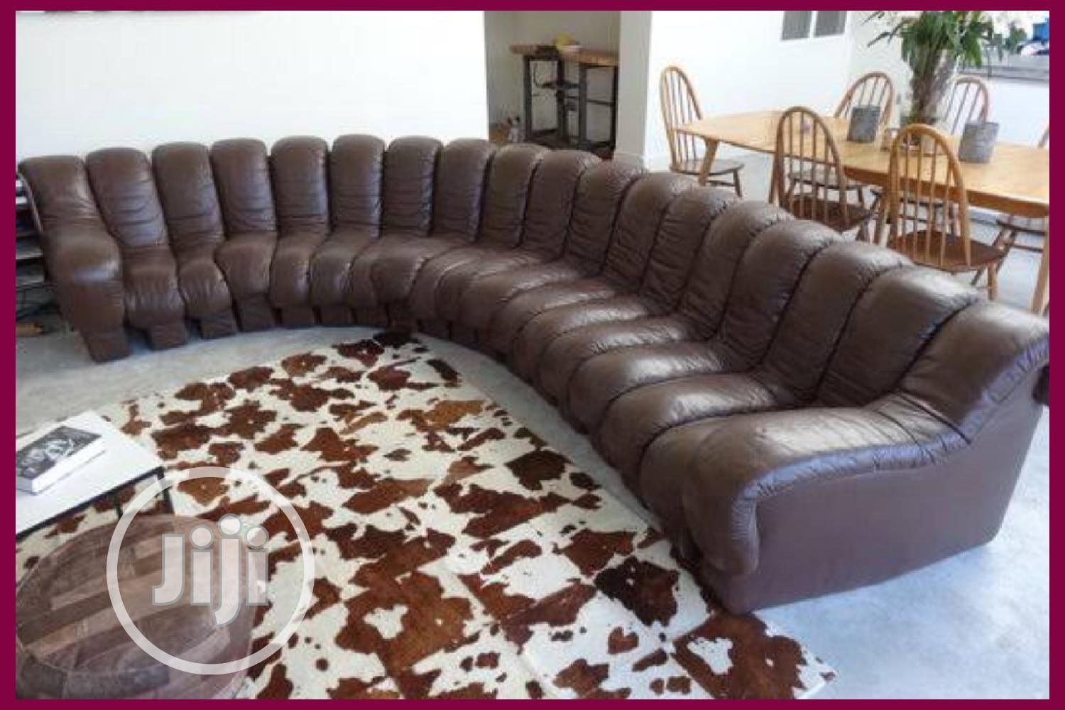 modern brown leather sofa with center table