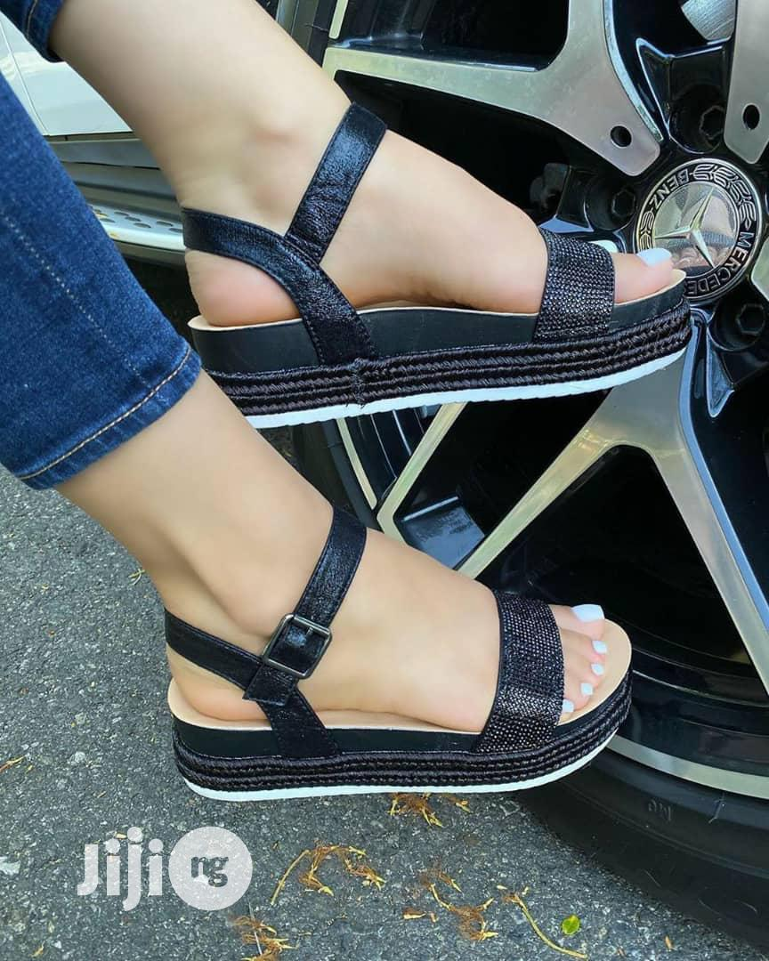 Archive: Gold And Black Sandals