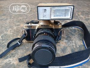 Used Analog Nikon Camera And Maxwell Flash   Photo & Video Cameras for sale in Edo State, Benin City