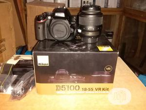 Brand New Nikon D5100 With Lens 18-55mm | Photo & Video Cameras for sale in Lagos State, Ojo