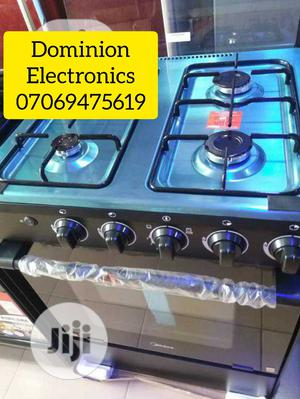 Original Midea Standing Gas Cooker 4burners With Oven 50×50   Kitchen Appliances for sale in Lagos State, Ojo