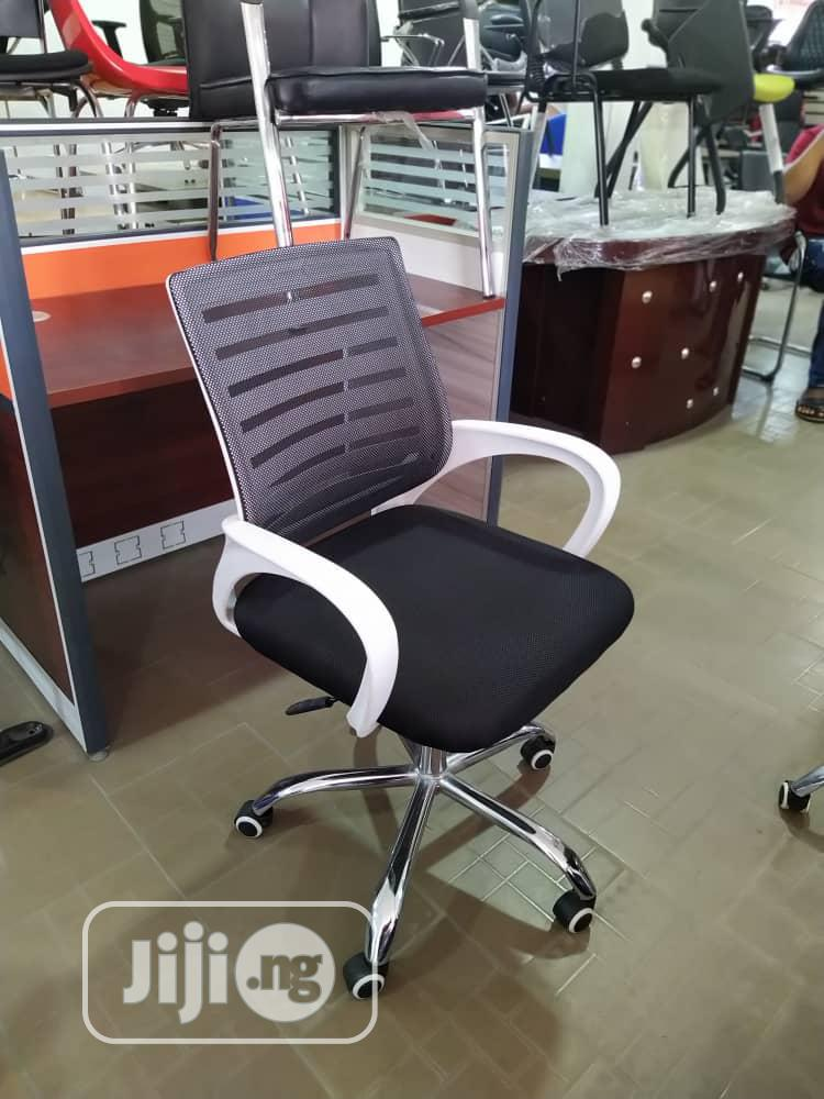 White And Black Swivel Chair