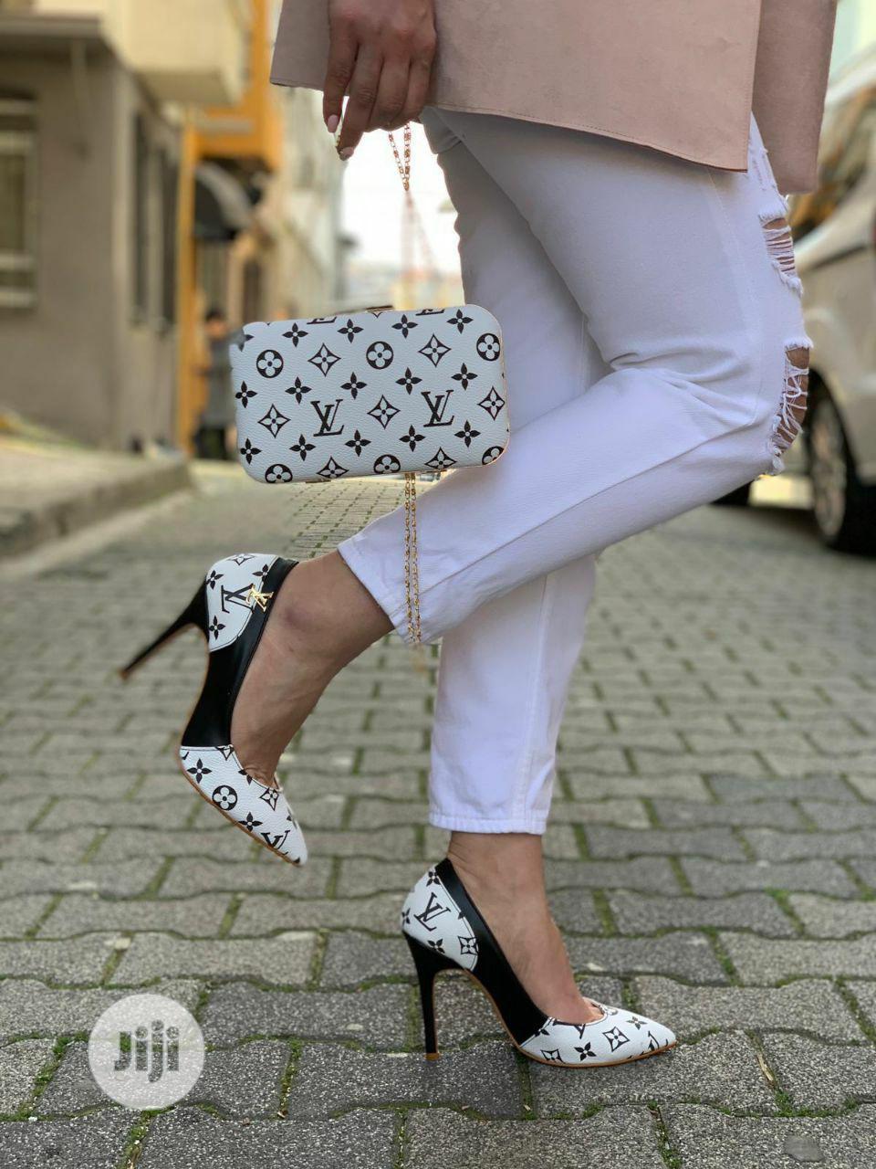 Louis Vuitton Designer's Set Of Shoe And Bag