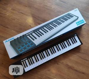 Alesis V61 Midi Keyboard Controller With Drum Pads   Musical Instruments & Gear for sale in Lagos State, Ojo
