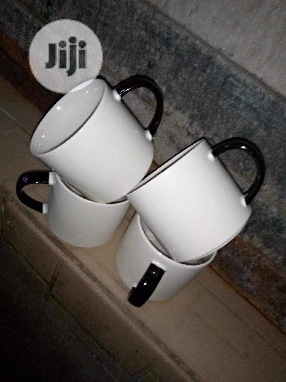 White And Black Handle Mug