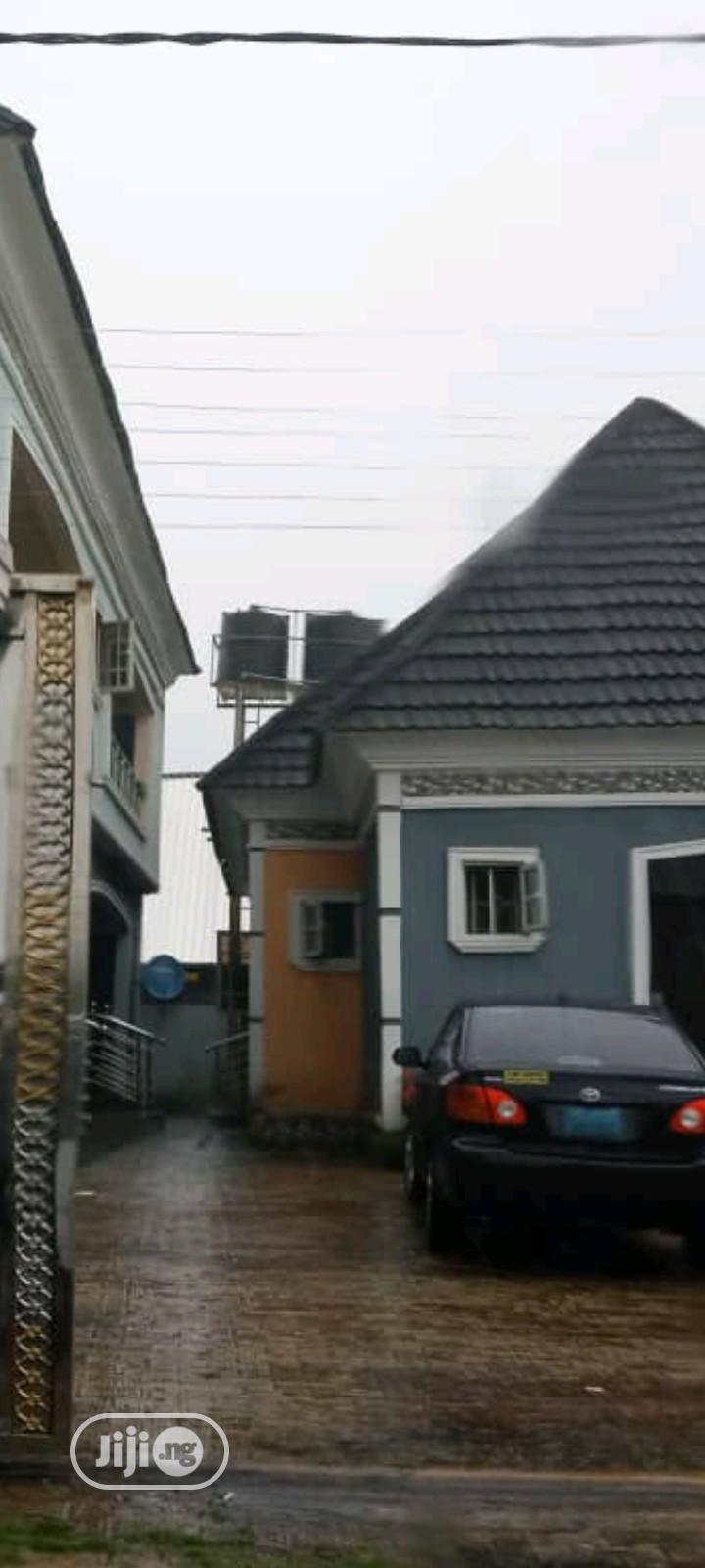 4flats of 3bedroom Flat With a Furnished Bungalow for Sale
