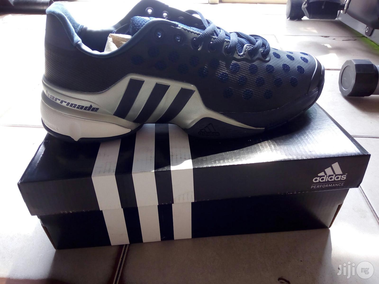 Adidas Lawn Tennis Shoes.