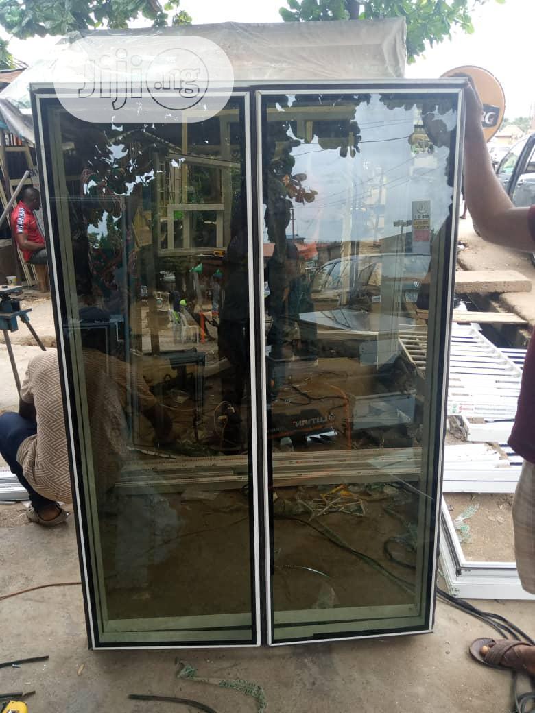 Frameless Window With Burglary And Net