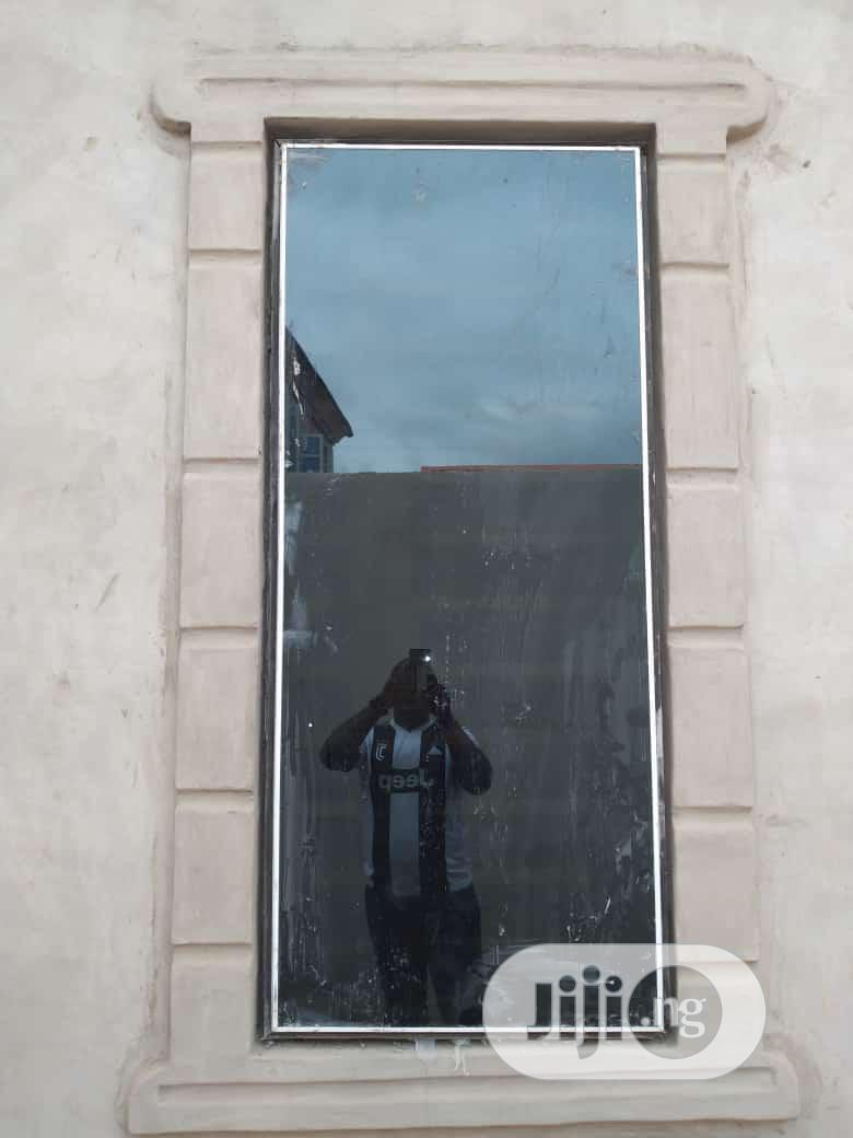 Frameless Window With Burglary And Net   Windows for sale in Agege, Lagos State, Nigeria