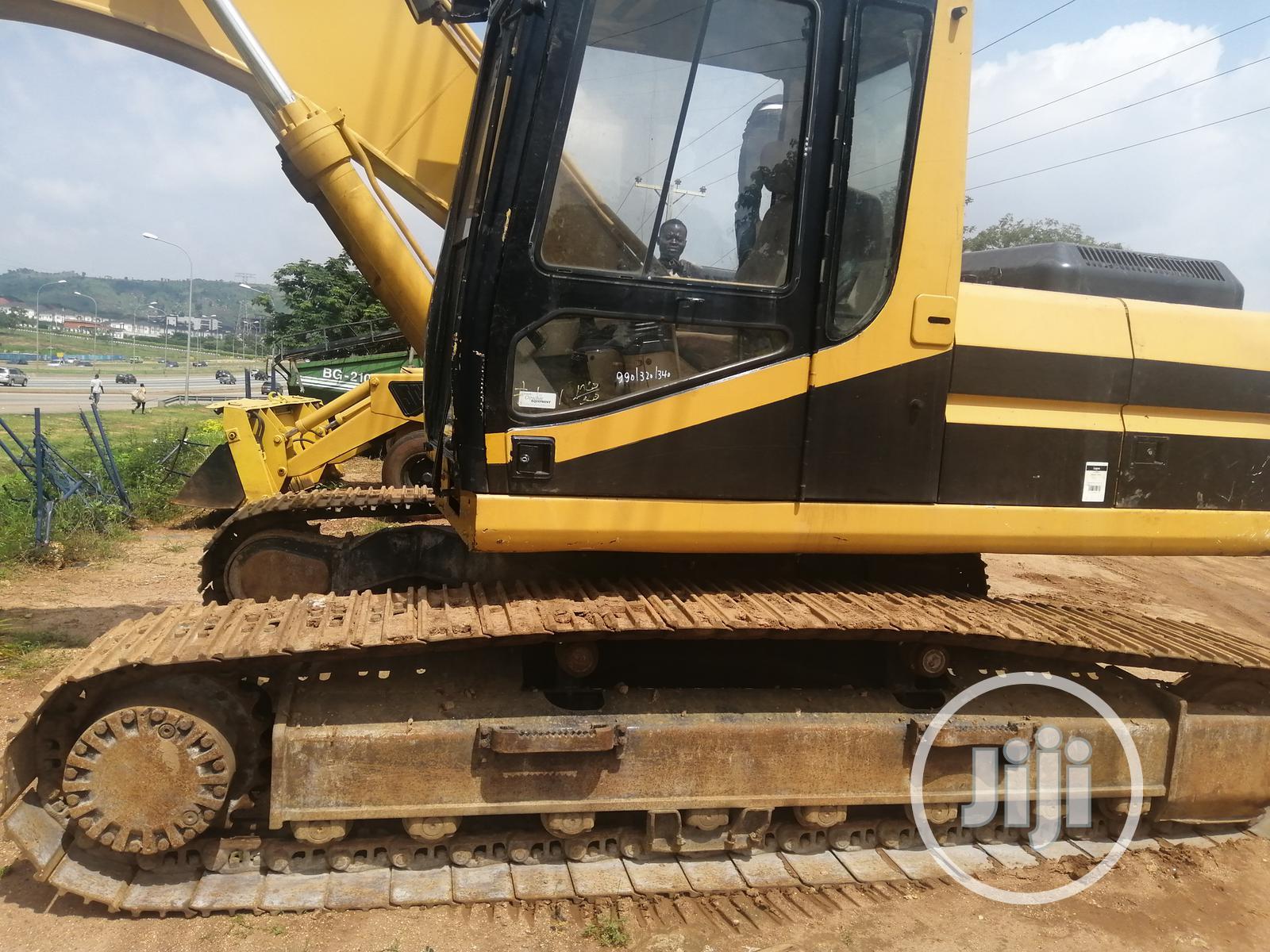 Archive: Direct Belgium 320CAT Excavator