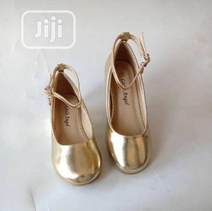 Archive: Beautiful Gold Wedge Heel Shoe