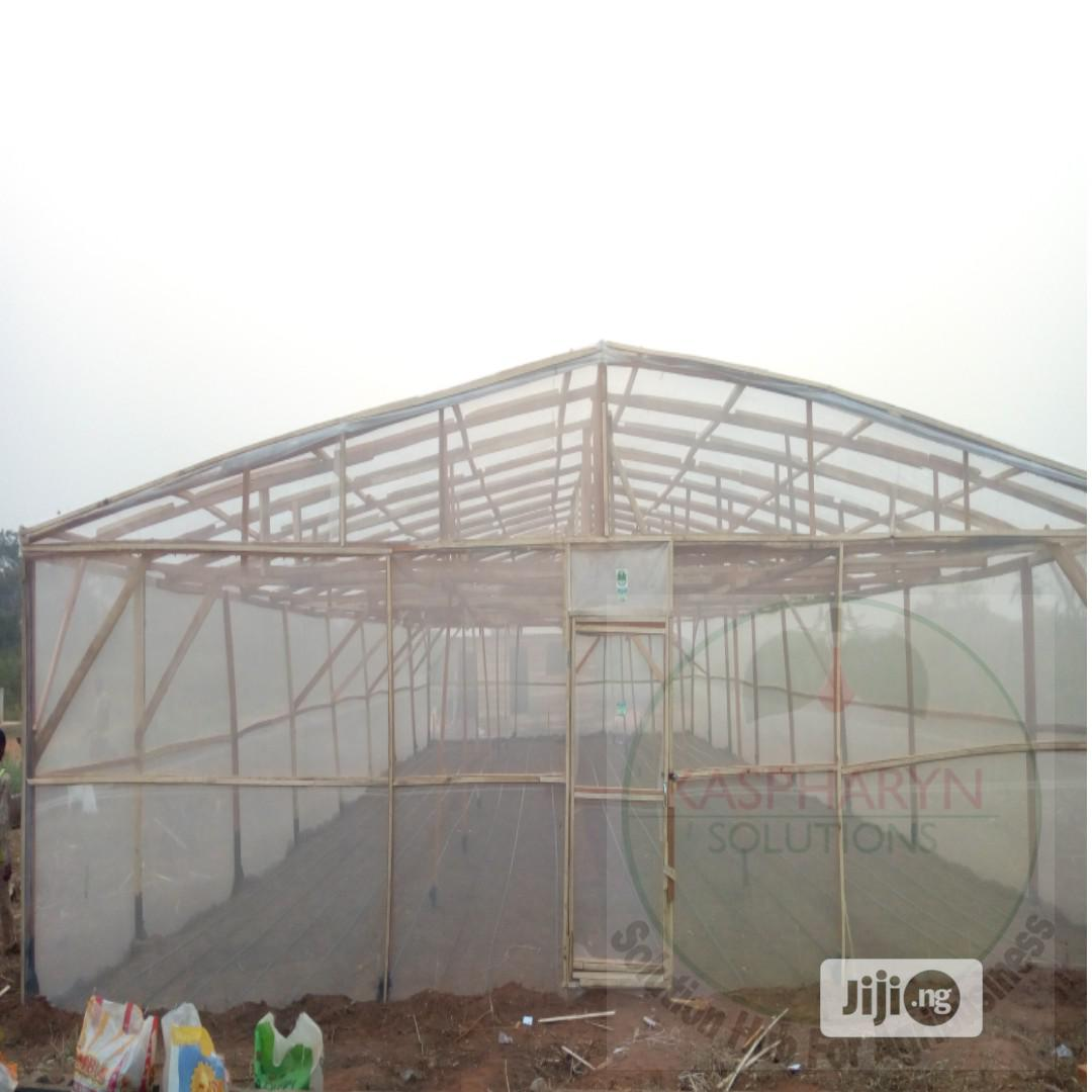 Wooden Greenhouse And Drip Irrigation Installation